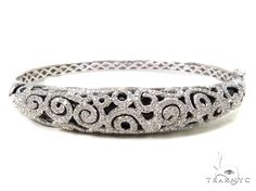 Treat yourself to this magnificent Bracelet that you will wear forever.This Bracelet is highlighted with SI1 quality G color Round cut diamonds. What an outstanding value! This Bracelet with its combination of exceptional 14k White Gold and diamonds will leave you breathless. You wont get a better price on Diamond Jewelry collection than we offer here at TraxNYC.