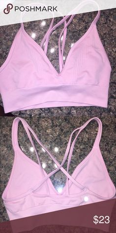 LULULEMON athletica sports bra size 6 Lulu sorts bra size 6 baby pink SO CUTE just doesn't fit my boobs but adds cleavage and the back criss crosses and looks adorable in tops lululemon athletica Intimates & Sleepwear Bras