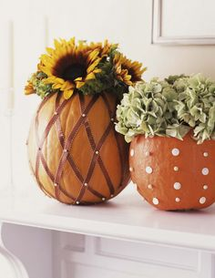 Transform your pumpkins into sophisticated vases with autumnal flower arrangements inside.