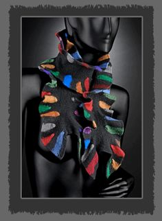 This scarf's ruffled edges create a collar around your neck. Made from Merino Wool & Silk blends. Knitted then felted