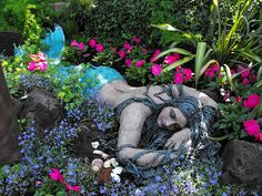 Mermaid statue in garden bed ♥ Edmonton Alberta. Mermaid Sculpture, Sculpture Art, Mermaid Statue, Garden Sculptures, Outdoor Statues, Garden Statues, Amazing Gardens, Beautiful Gardens, Mermaid Fairy