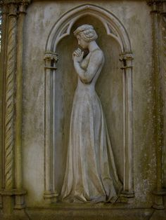 Stilles Gebet (Silent or Hushed Prayer) . Sculpture of a female figure on one of the older graves in The Frankfurt Main Cemetery of Frankfurt, Germany