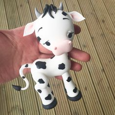 One tutorial. Many possibilities! :)  http://crumbavenue.com/tutorials/cute-cow-topper