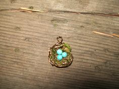 Best seller mossy bird nest pendant. Cute as a button and a great gift!https://www.etsy.com/your/listings