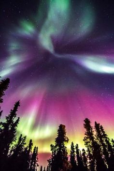 Beautiful aurora in Fairbanks Ak on St Patricks day.I want to go see this place one day.Please check out my website thanks. www.photopix.co.nz