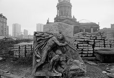 "Thomas Hoepker EAST GERMANY. East Berlin. 1974. Platz der Akademie (formerly and now once again called ""Gendarmenmarkt"") with its run-down reliefs. In the background, the newly-constructed tower blocks in Leipziger Strasse in East Berlin."