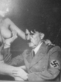 Adolf Hitler holding a boob
