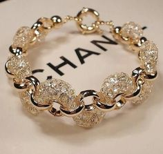Chanel ~ Modern Gold & Diamond Bracelet. The Diamonds Are Set Into Gold Netting Then Woven Through The White Gold Links. Such A Unique & Beautiful Design.