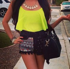 Neon yellow flounce top and high waisted Aztec shorts
