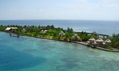 Private island resort with over-water bungalows, cabanas, and daily meals; near world's second-largest barrier reef