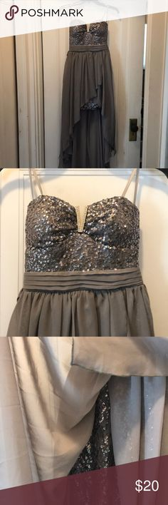 Gray Dress Sequined top with V shaped metal cutout in middle. High low style draped over bottom half. Sparkles section hits mid thigh. Tie around back belt attached and zip up. As U Wish Dresses Prom