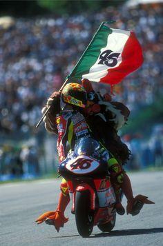 """Celebrate it like a Rossi! Valentino ROSSI, Nastro Azzurro Aprilia, Aprilia RSW 250, 1998 GP Marlboro De Catalunya, 250cc Race, Circuit de Catalunya, Barcelona, Sunday 20 September 1998, finished 1st """"il pollo Osvaldo"""""""