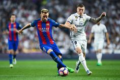 Ivan Rakitic of FC Barcelona competes for the ball with Toni Kroos of Real Madrid CF during the La Liga match between Real Madrid CF and FC Barcelona at the Santiago Bernabeu stadium on April 23, 2017 in Madrid, Spain.