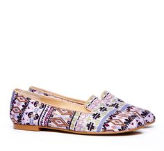 slip on flats in a native american inspired print.