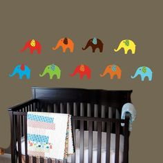 Modern Elephant Wall Decal Set of 9 Vinyl Stickers. $39.99, via Etsy.