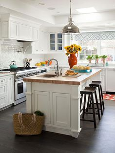 White cabinet - closed up top, nice open windows, apron sink, like the oven, clean and simple hardware. May have done the countertop in a more rounded edge in a light gray or speckled/swirly grey/white marble.