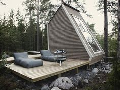 Finnish mini cottage by Robin Falck. The design is small enough to be built without a permit.  It is made of recycled materials so it is both beautiful and green. Robin Falck estimates the total spent on the cabin at around 10,000€ :)        Finland, Finnish Design, Sustainable Design Innovation, Eco Architecture, Green Building, Summer Cottage
