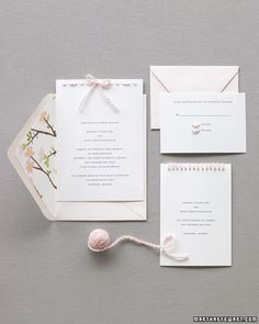 With warm and fuzzy yarn accents, a plain stationery set becomes wedding-worthy. Make tiny dots where you want holes for stitches to be (or have them printed, if you can). Choose a textured stock and matching envelope (we lined ours with gift wrap), and a soft ink color to make cards refined.