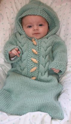 Knitting pattern for Cabled Baby Bunting cocoon and a bunch of other cute free baby patterns.