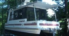 sampling of L'il Hobo Trailerable Houseboats: We used to have a 20' pontoon boat and loved it other then it wasn't set up to be able to sleep overnight. We used to pull a tarp over the bimini top and