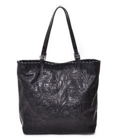 Carla Mancini Black Tall Tooled Leather Tote | zulily14.5'' W x 15'' H x 6'' D 9'' handle drop Outer: leather Lining: cotton / polyester Magnetic snap closure Interior: one zip and one slip pocket Made in the USA