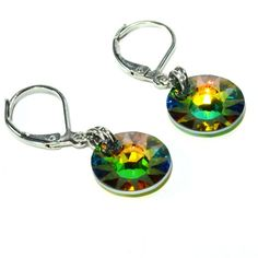 Great crystal dangle earrings for everyday ;) Stunning rainbow colors, tons of flash. Original Le French Gem design made with color changing, genuine sparkly Swarovski crystals, 12mm. Earrings dangle just over 1/2 inch.  Comfortable silver lever backs are nickel free and tarnish resistant and Gypsy Jewelry, Yoga Jewelry, Silver Earrings, Dangle Earrings, Shops, Sister Jewelry, Irish Jewelry, Expensive Jewelry, Etsy Shop