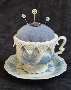 . Pretty way to use a collect able cup and saucer..like the lace trim.