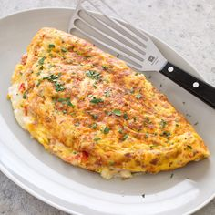 This omelet is big enough to serve four, but it still has the merits of an individual omelet: tender not tough eggs and a filling that doesn't weigh down the eggs.