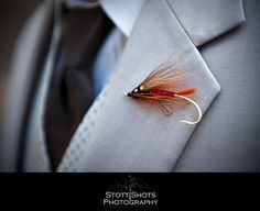 Fly fishing boutonniere! Such a great way to incorporate the groom's hobby into the wedding!