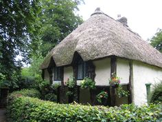 Thatched roof cottage in Cockington Village, Torquay, Devon, England