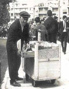 an old photo of a person selling warm peanuts and pumpkin seeds Greece History, Greece Pictures, Greek Culture, Greek Isles, Good Old Times, History Of Photography, Athens Greece, Eastern Europe, Vintage Pictures