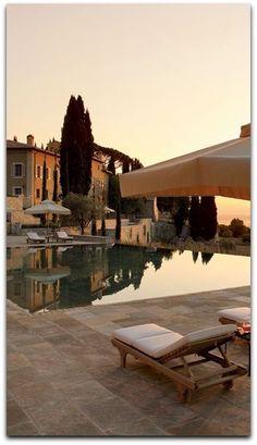 The pool at Castiglion del Bosco, a resort developed by fashion mogul Massimo Ferragamo and his wife, Chiara, on a 4,000-acre estate that incorporates a 12th-century hilltop village near Montalcino.