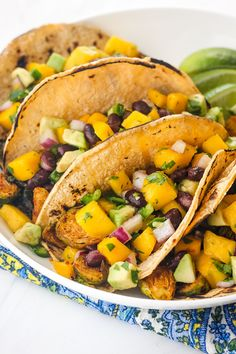 Crispy roasted Brussels sprouts topped with a sweet and spicy mango avocado salsa. Take your Taco Tuesday to the next level with this tasty vegetarian recipe! Tasty Vegetarian Recipes, Vegetable Recipes, Veggie Nachos, Roasted Sprouts, Pasta Dinners, Meals, Mango Avocado Salsa, Cooking Black Beans, Brussels Sprouts
