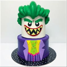 Like most parents, I'm not sure there is a room in my house that doesn't have LEGO in it. So, this wonderful LEGO Joker cake brought a big smile to my face. This fun cake. Lego Batman Cakes, Batman Birthday Cakes, Lego Batman Party, Lego Cake, Lego Superhero Cake, Minion Cakes, Minecraft Cake, Joker Cake, Batgirl Cake