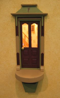 Tooth Fairy door in reception wall of Dentist Dr. Kay Wilson, DDS :: Ingenious idea, set at just the right height for small children to peek inside :: pic 1 of 3 Tooth Fairy Doors, House Doors, Fairy Land, Fairy Houses, Faeries, Teeth, Dental, Urban, Crafty