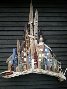 Kæmpe Drivtømmer by - Ranum. Huges driftwood town/houses. by EVAS.