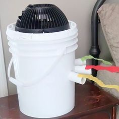 Cool it! All you need is a bucket, a fan, and a plastic bottle filled with ice.