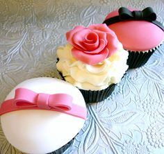 Trio of pink, white and black cupcakes