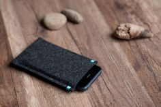 Handmade felt sleeve for iPhone 4/4s, iPhone 5/5s/5c. It will fit the phone perfectly and protect it from dust and scratches. The phone sits in the sleeve tight enough as to protect it from...