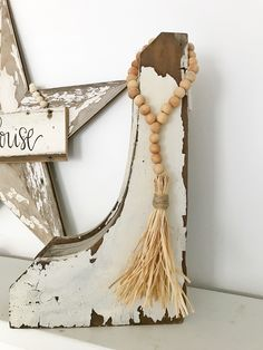 How to style wood bead garlands. - The Pickled Rose Wood Bead Garland, Tassel Garland, Wooden Bead Necklaces, Wooden Beads, Cute Crafts, Bead Crafts, Deco Boheme Chic, Antique Booth Ideas, Wood Burning Crafts