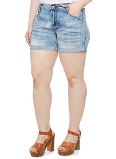 Rainbow Plus Size Whisker Wash Denim Shorts with Rolled Cuffs   Give new life to your warm weather wardrobe with these plus size shorts.  Great for everyday wear, these shorts feature flattering whisker-wash denim, two functional front pockets and faux welt pockets in the back.  These shorts are completed with sewn rolled cuffs, double belt loops and a button closure with a zip fly.  Style these plus size jean shorts with an embroidered peasant top and a rose gold watch.