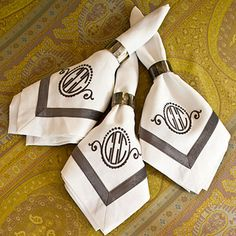 Shy Away from Basic Linens | Choose a pretty patterned tablecloth for an additional element of color and texture. Complement that by selecting solid napkins that are embellished with a bold monogram.