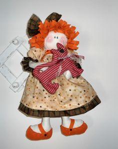 bambola con gattino