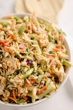 Thai Peanut Chicken Crunch Slaw Salad is an easy & healthy cold salad that is loaded with fresh flavor and crunch! Coleslaw and broccoli slaw are tossed with cucumbers, carrots, bell peppers and chick Thai Peanut Chicken, Thai Chicken Salad, Thai Peanut Salad, Chicken Salad Healthy, Thai Crunch Salad, Best Chicken Salad Recipe, Healthy Salads, Chicken Recipes, Thai Cucumber Salad
