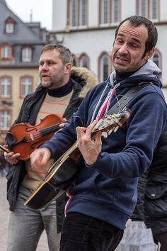 Inspirational  artists in the market place in Trier Germany Musiker auf dem Hauptmarkt
