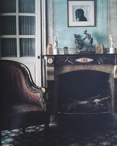 In the bedroom of Madeleine Castaing's apartment on Rue Jacob. The portrait of her above the mantel was by Louise de Vilmorin. World of Interiors, May 1986.