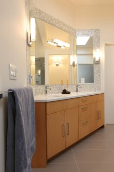 hansgrohe metris Bathroom Midcentury with bamboo cabinet bathroom tile curbless shower Daltile floor tile
