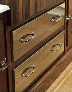 Two deep drawers for pots and pans are faced in stainless steel to break up the length of the island. #ChristopherPeacock