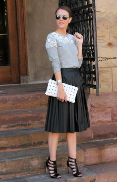 Embellished Sweater and Leather Skirt together for an edgy combination; Not so sure about the clutch though