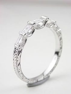 Wedding Band with Baguette Cut Diamonds, RG-1739wbc.    I love vintage style rings. The amount of detail that go into them is rather amazing. Sometimes, it can be a little much so finding that balance can be tricky. I'm a fan of this ring, it would sit nicely on the finger and won't protrude out too much.